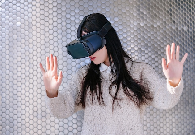 Woman using vr glasseshone