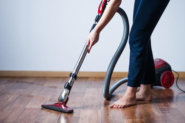 Woman vacuuming floors