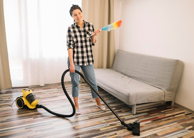 Woman vacuuming in living room