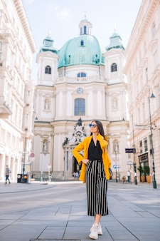 Woman in vienna with st. peter church on the background