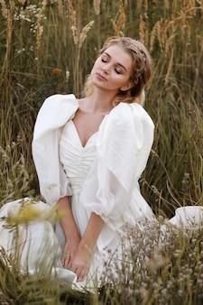 Woman in vintage white dress