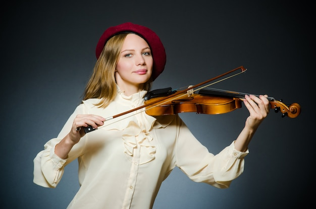 Woman violin player in musical concept