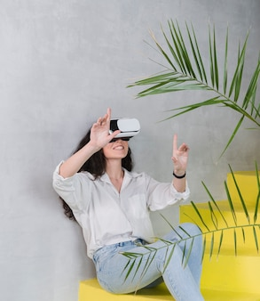 Woman and virtual reality headset and plants