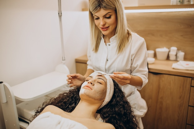 Woman visiting cosmetologist and making rejuvenation procedures