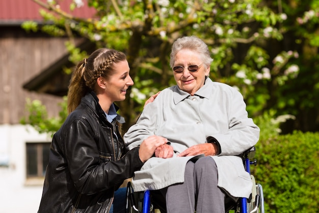 Woman visiting grandmother in nursing home