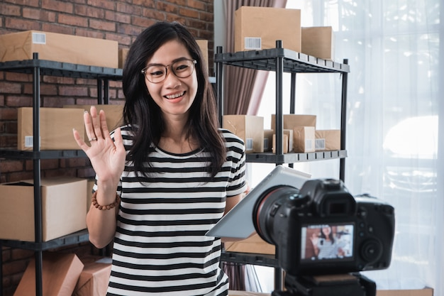 Woman vlogging in front of packages shelf