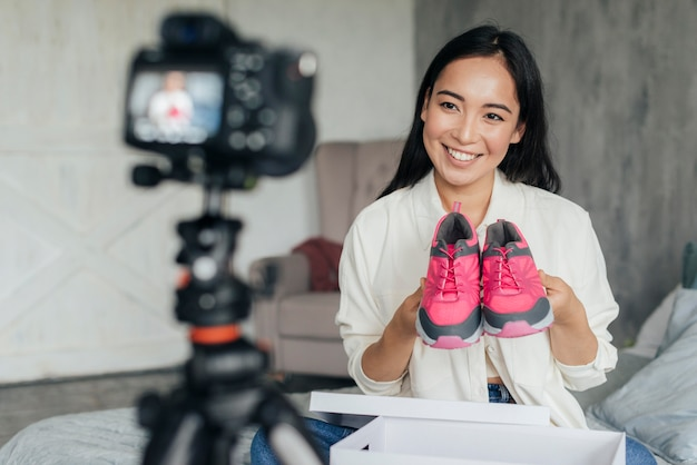 Woman vlogging with her sports shoes
