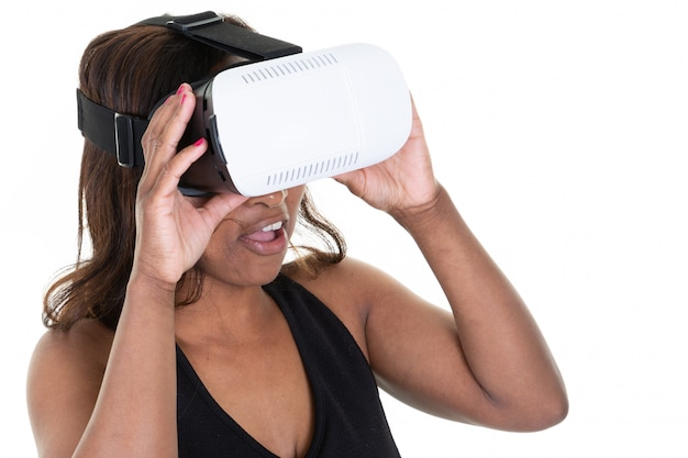 Woman in vr headset looking up and trying to touch objects on white background