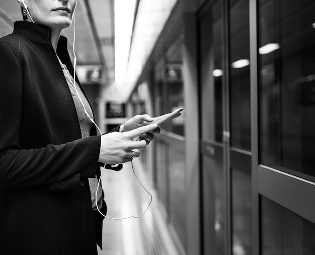 Woman waiting subway terminal transportation concept
