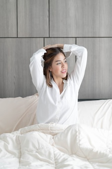 Woman wake up on bed