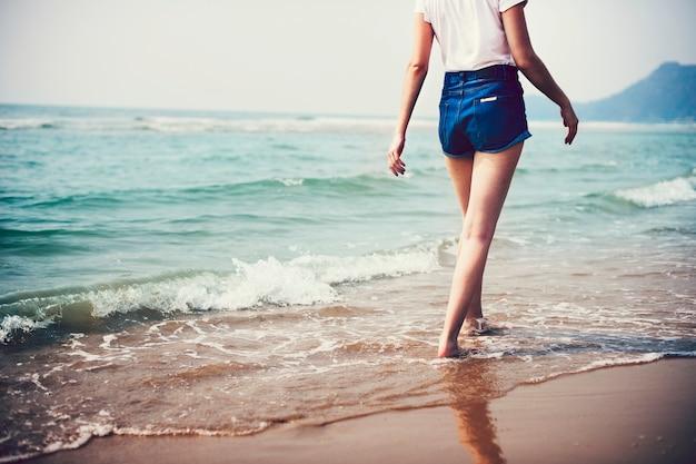Woman walking along the beach
