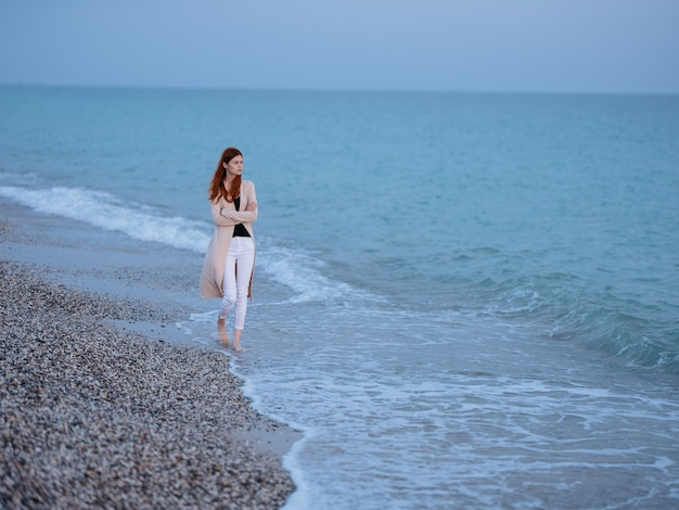 Woman walking by the ocean rest freedom romance