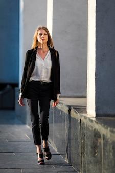 Woman walking to camera long shot