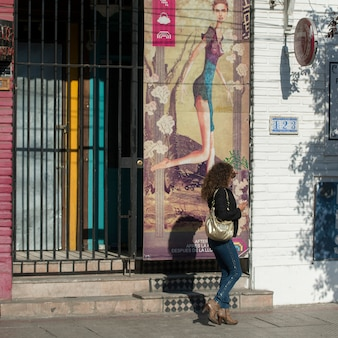 Woman walking in front of a house, santiago, santiago metropolitan region, chile