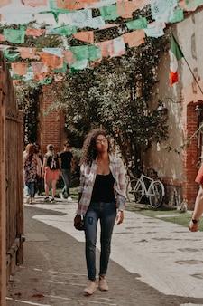 Woman walking in a little town