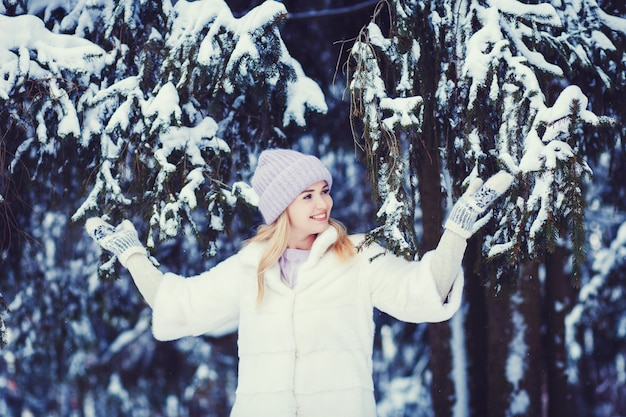 Woman walking in a park and smiling