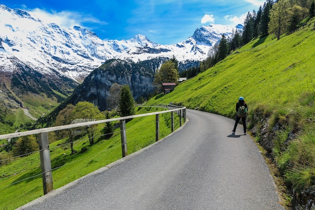 Woman walking on the road at gimmelwald & murren villages in switzerland