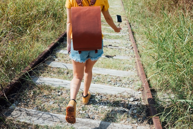 Woman walking through railroad track