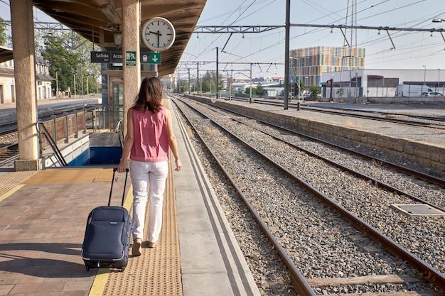 Woman walking in a train station