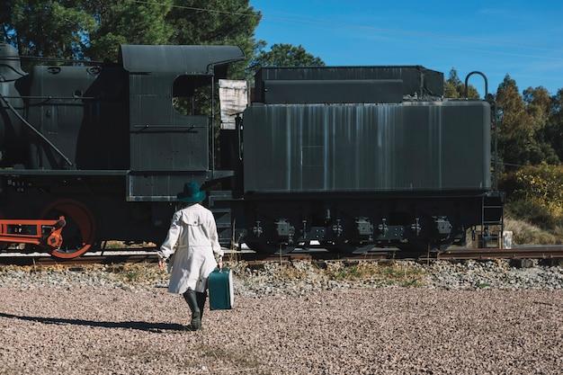 Woman walking to vintage train