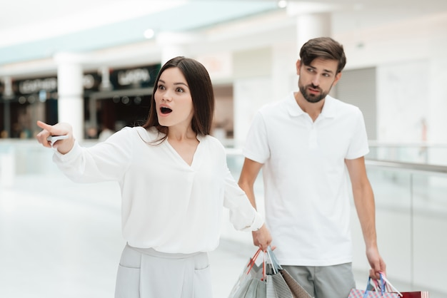 Woman wants to go to new store but man is tired.