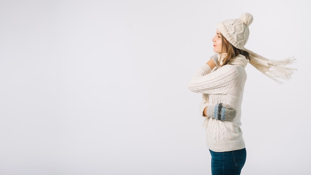 Woman in warm clothes on white background