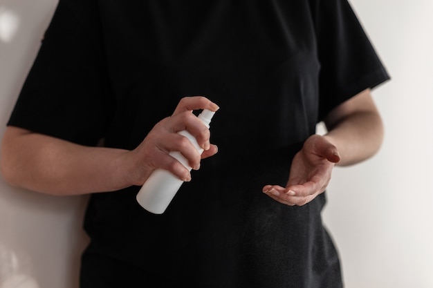 Woman washes her hands with an antiseptic spray against germs, viruses and bacteria. coronovirus protection