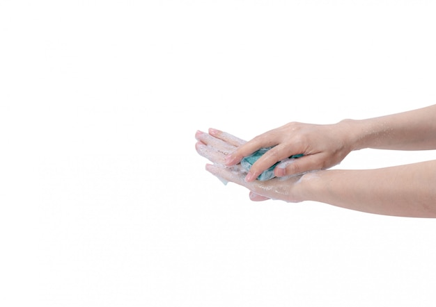 Woman washing hand with soap bar and water. hand clean for good personal hygiene . procedure of hand wash to kill germs, virus, bacteria. cleaning dirty hands.