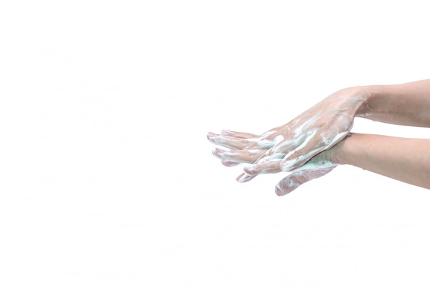 Woman washing hand with soap foam and water.