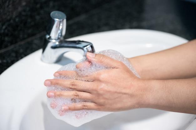 Woman washing hand