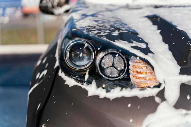 Woman washing her car outdoors