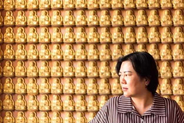 Woman at wat boromracha kanchanapisek anusorn