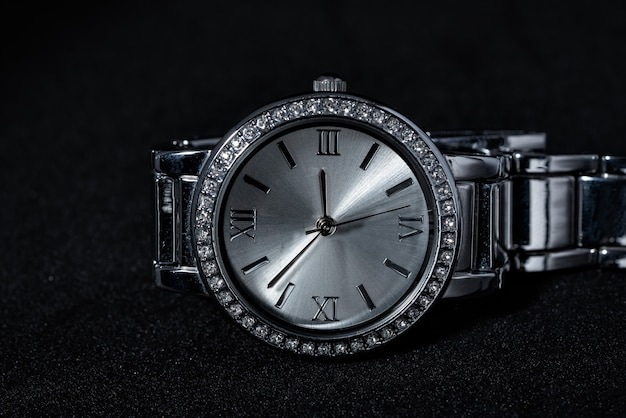 Woman watch with diamond on black background