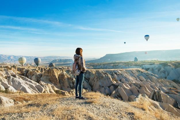 Woman watching hot air balloons in cappadocia