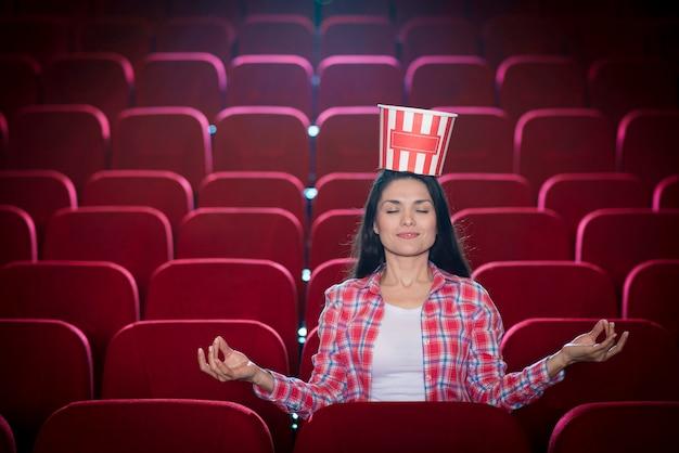 Woman watching movie in cinema