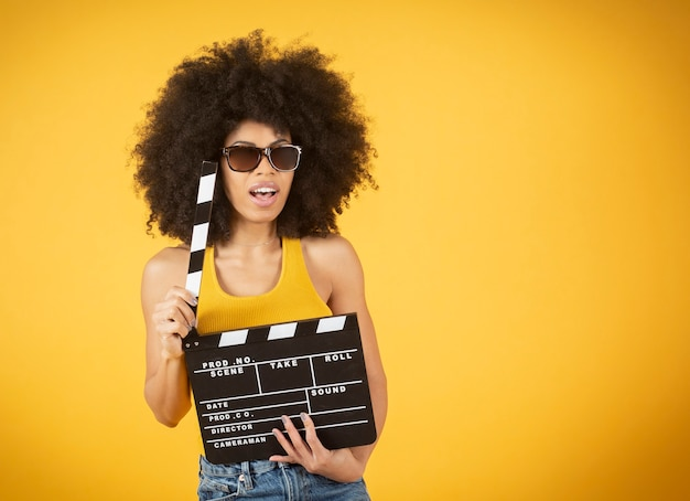 Woman watching movie with a clapperboard