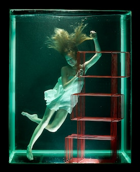 Woman in water with a red bookcase