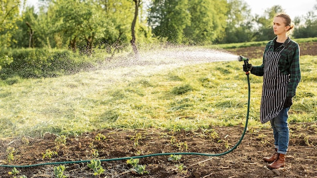 Woman watering the crops