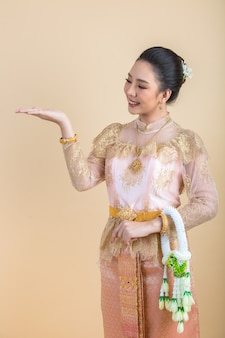 Woman wearing an ancient thai dress