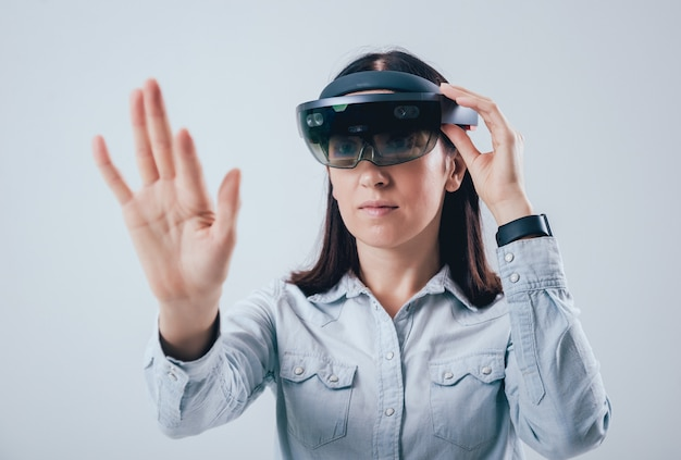 Woman wearing augmented reality goggles.