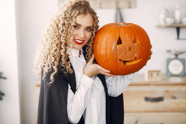 Woman wearing black costume. lady with halloween makeup.