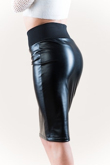 Woman wearing a black leather skirt