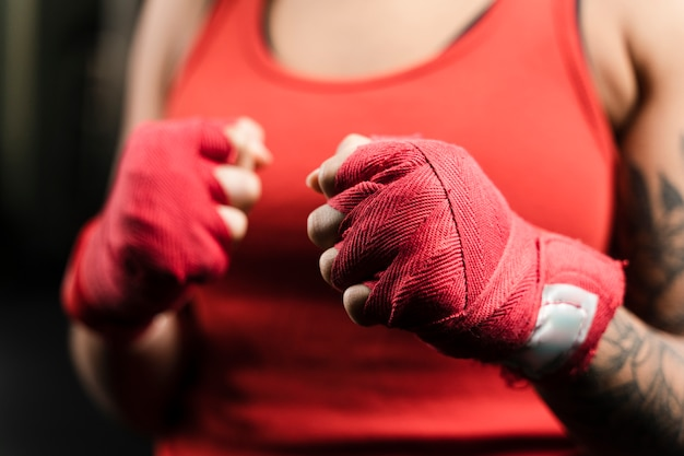Woman wearing boxing gloves for training