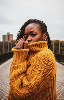 Woman wearing brown knit sweater