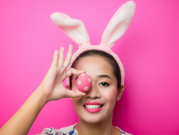 Woman wearing bunny ears headband during easter.