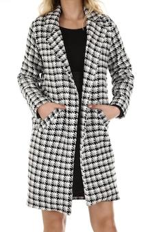 Woman wearing a coat in studio