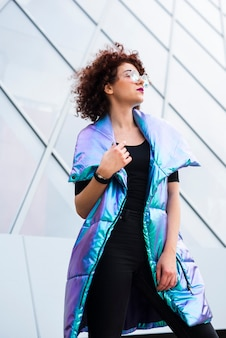 Woman wearing colorful vest
