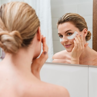 Woman wearingunder eye bags treatment patches