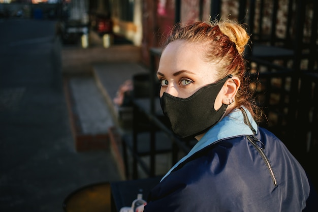 Woman wearing a face mask to protect against pollution or disease