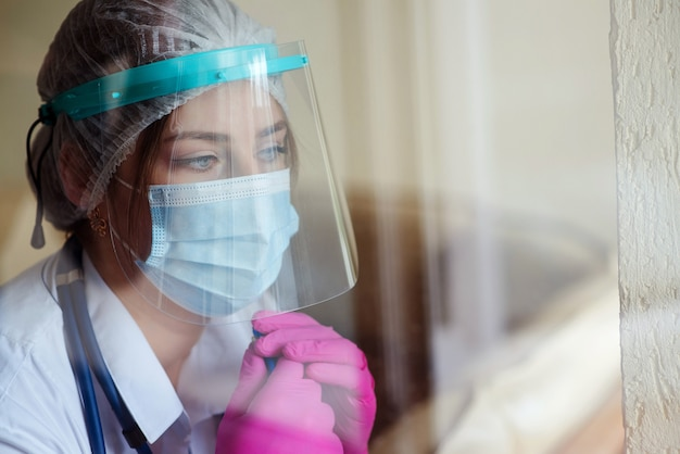 Woman wearing face shield and protective mask during covid19 quarantine